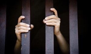 hands_bars_prison_jail