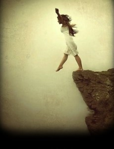 woman-on-cliffs-edge