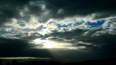 Sun peaking through clouds